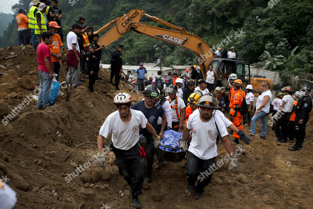Rescuers carry a body recovered from the site of a landslide in Cambray, a neighborhood in the suburb of Santa Catarina Pinula, about 10 miles east of Guatemala City, . The hill that towers over Cambray collapsed late Thursday after heavy rains, burying several houses with dirt, mud and rocks. Family members have reported 100 people missing, but the number could be as high as 600 based on at least 100 homes in the area of the slide, said Alejandro Maldonado, executive secretary of Conred, the country's emergency disaster agency