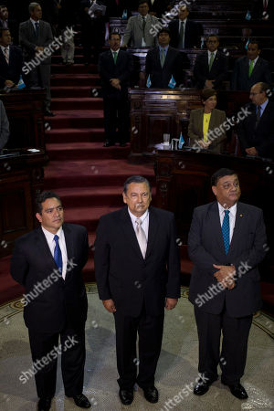 Juan Alberto Fuentes Soria, Carlos Herrera, Rdgar Cristiani Flanked by Congressmen Edgar Cristiani, left, and Carlos Herrera, right, Juan Alfonso Fuentes Soria attends his swearing-in ceremony as Guatemala's new Vice President, in Guatemala City, . Fuentes replaces Alejandro Maldonado, who was briefly vice president before he assumed the presidency following the resignation of Otto Perez Molina two weeks ago