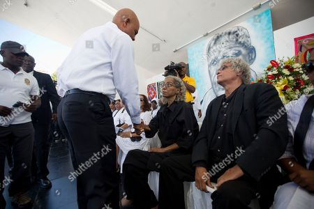 """Stock Photo of Rachel Beauvoir Dominique, Michel Joseph Martelly Haiti's President Michel Joseph Martelly, left, greets Rachel Beauvoir Dominique, the daughter of late Voodoo chief Max Beauvoir, during her father's funeral in Port-au-Prince, Haiti, . On his Twitter account, Martelly described Beauvoir's death as a """"great loss for the country."""" Beauvoir died Saturday at age 79"""