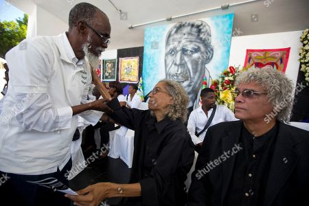 Rachel Beauvoir Dominique A Voodoo believer greets Rachel Beauvoir Dominique, the daughter of late Voodoo chief Max Beauvoir, during her father's funeral ceremony in Port-au-Prince, Haiti, . Max Beauvoir, who died Saturday at age 79, was a biochemical engineer who earned degrees abroad and became a Voodoo priest when he returned to his Caribbean homeland in the 1970s