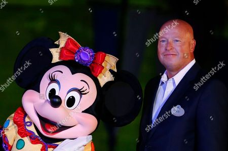 Bob Chapek Chairman of Walt Disney Parks and Resorts Bob Chapek poses with Minnie Mouse during a ceremony at the Hong Kong Disneyland, as they celebrate the Hong Kong Disneyland's 10th anniversary