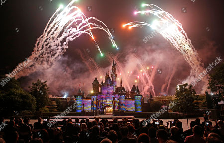 Bob Chapek, Leung Chun-ying Fireworks explode over the Sleeping Beauty Castle during a ceremony at the Hong Kong Disneyland, as they celebrate the Hong Kong Disneyland's 10th anniversary