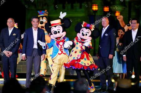 Bob Chapek, Leung Chun-ying Chairman of Walt Disney Parks and Resorts Bob Chapek, second right, and Hong Kong Chief Executive Leung Chun-ying, second left, pose with Mickey Mouse and Minnie Mouse in front of the Sleeping Beauty Castle, during a ceremony at the Hong Kong Disneyland, as they celebrate the Hong Kong Disneyland's 10th anniversary