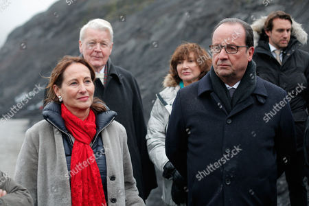 France's President Francois Hollande, right, and Environment Minister Segolene Royal, folioed by Iceland's President Olafur Ragnar Grimsson, second left, and Iceland's First Lady, Dorrit Moussaieff listen to a scientist on the Solheimajokull glacier, where the ice has retreated by more than 1 kilometer (0.6 miles), during a State visit in Iceland, . Francois Hollande is in Iceland to experience firsthand the damage caused by global warming, ahead of major U.N. talks on climate change in Paris this year