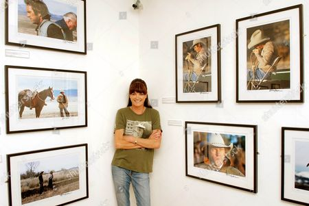 Barbara McQueen standing next to her photographs from 'Steve McQueen: Photographs from The Last Mile', which is a personal collection of photographs taken by Steve's third wife and former model, Barbara McQueen. It chronicles Barbara's early history and successful modeling career, her years with Steve at Trancas Beach where they faced the outrageous antics of unlikely neighbour The Who's Keith Moon and Steve's flying lessons at Santa Paula where the couple set up home in an airplane hanger. The book ends with a poignant look into Steve's final days when, diagnosed with terminal cancer, he found solace in his conversion to Christianity. An exclusive limited edition selection of photographs featured in the book S'teve McQueen: Photographs from The Last Mile' will go on sale at the Movie Poster Art Gallery, Saturday 16th June, running to Saturday 7th July