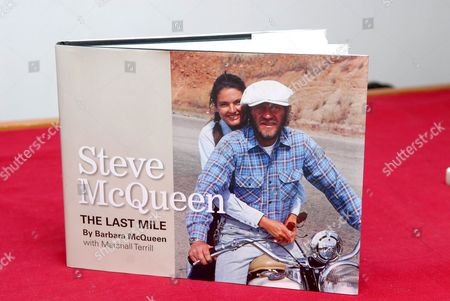 A copy of the book 'Steve McQueen: Photographs from The Last Mile', which is a personal collection of photographs taken by Steve's third wife and former model, Barbara McQueen. It chronicles Barbara's early history and successful modeling career, her years with Steve at Trancas Beach where they faced the outrageous antics of unlikely neighbour The Who's Keith Moon and Steve's flying lessons at Santa Paula where the couple set up home in an airplane hanger. The book ends with a poignant look into Steve's final days when, diagnosed with terminal cancer, he found solace in his conversion to Christianity. An exclusive limited edition selection of photographs featured in the book S'teve McQueen: Photographs from The Last Mile' will go on sale at the Movie Poster Art Gallery, Saturday 16th June, running to Saturday 7th July