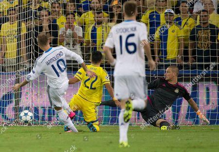 Dynamo Kiev's Andriy Yarmolenko scores by Maccabi Tel Aviv's goalkeeper Predrag Rajkovic during a group G Champions League soccer match in Haifa, Israel