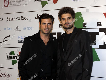 Stock Image of Luka Sulic, Stjepan Hauser Cellists Luka Sulic, right, and Stjepan Hauser pose for photographers as they arrive for the ' Celebrity Fight Night ' foundation gala dinner, in Florence, Italy