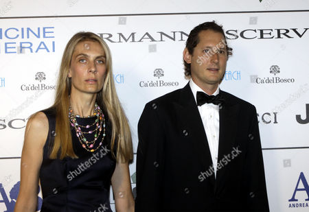 Lavinia Borromeo, John Elkann Fiat Chairman John Elkann, right, and his wife Lavinia Borromeo pose for photographers as they arrive for the ' Celebrity Fight Night ' foundation gala dinner, in Florence, Italy
