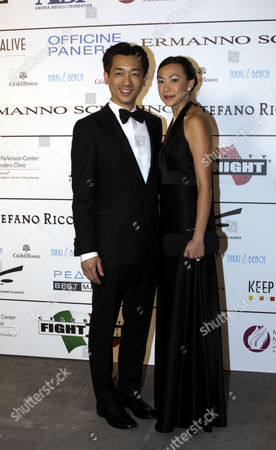 Bee Taechaubol Thai businessman Bee Taechaubol, left, and his wife pose for photographers as they arrive for the ' Celebrity Fight Night ' foundation gala dinner, in Florence, Italy