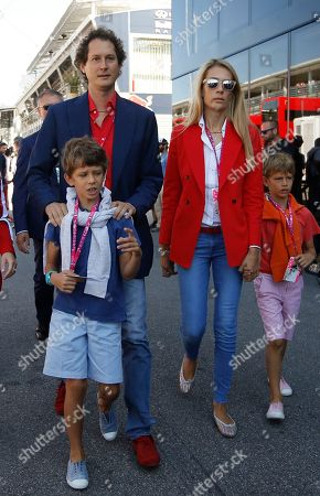 Fiat president John Elkann and his wife Lavinia Borromeo walk in the paddock prior to the Formula One Italian Grand Prix, at the Monza racetrack, Italy