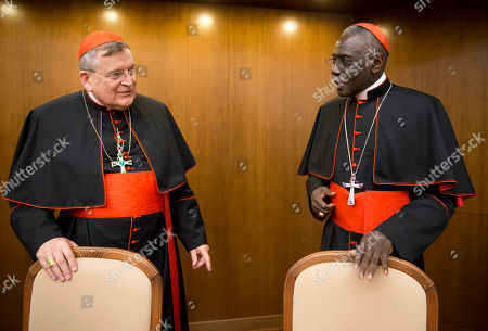 Cardinal Raymond Leo Burke, left, talks with Cardinal Robert Sarah, prefect of the Congregation for Divine Worship and the Discipline of the Sacraments, as he arrives for the presentation of his book Divine Love Made Flesh, in Rome