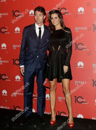 AC Milan's Riccardo Montolivo poses with his wife Cristina De Pin during a party to celebrate Vogue China 10th anniversary, in downtown Milan, Italy