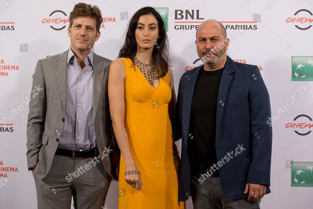 From left, director Assaf Bernstein, and actors Laetitia Eido and Lior Raz pose for photographers during the photo call of the movie Fauda, at Rome's Film Festival, in Rome