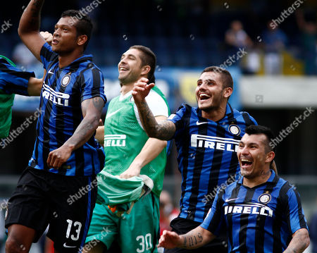 From left, Inter Milan's players Fredy Guarin, Juan Pablo Carrizo, Mauro Icardi and Gary Medel celebrate at the end of a Serie A soccer match against Chievo at Bentegodi stadium in Verona, Italy, . Inter won 1-0
