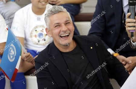 Italian soccer legend Roberto Baggio smiles as he attends an event at the Expo 2015 World's Fair on the occasion of the UN World Food Day in Rho, near Milan, Italy
