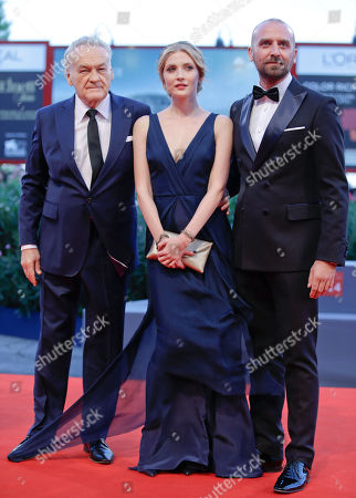 Jerzy Skolimowski, Paulina Chapko, Wojciech Mecwaldowski From left, director Jerzy Skolimowski and actors Paulina Chapko and Wojciech Mecwaldowski pose during the red carpet of the movie 11 Minutes, at the 72nd edition of the Venice Film Festival in Venice, Italy, . The 72nd edition of the festival runs until Sept. 12