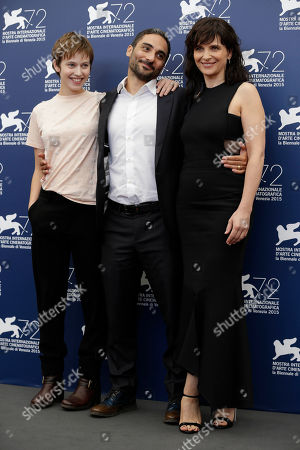 Lou de Laage, Juliette Binoche, Piero Messina Actresses Lou de Laage, left, and Juliette Binoche pose with director Piero Messina, center, during the photo call for the movie L'Attesa (The Wait) at the 72nd edition of the Venice Film Festival in Venice, Italy, . The 72nd edition of the festival runs until Sept. 12