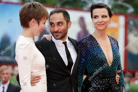 Stock Photo of Lou de Laage, Piero Messina, Juliette Binoche Lou de Laage, Piero Messina and Juliette Binoche pose for photographers at the premiere of the film L'Attesa (The Wait) during the 72nd edition of the Venice Film Festival in Venice, Italy, . The 72nd edition of the festival runs until Sept. 12