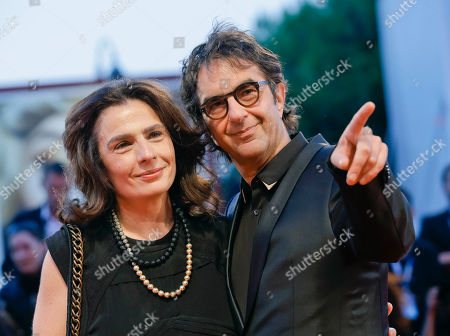 Atom Egoyan, Arsinee Khanjian Director Atom Egoyan, right, and his wife Arsinee Khanjian arrive for the screening of the movie Remember at the 72nd edition of the Venice Film Festival in Venice, Italy, . The 72nd edition of the festival runs until Sept. 12
