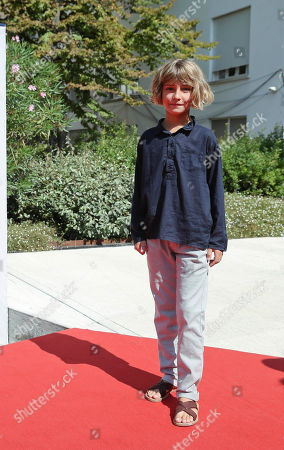 Stock Image of Tom Sweet Young actor Tom Sweet poses on the red carpet of the movie The Childhood of a Leader at the 72nd edition of the Venice Film Festival in Venice, Italy