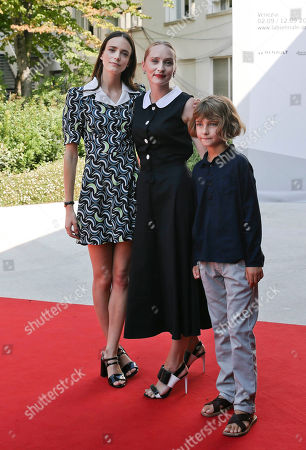 Stock Photo of Stacy Martin, Mona Fastvold, Tom Sweet From left, actress Stacy Martin, co-writer Mona Fastvold, and young actor Tom Sweet arrive for the red carpet of the movie The Childhood of a Leader at the 72nd edition of the Venice Film Festival in Venice, Italy