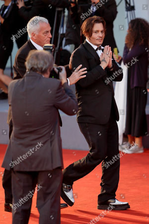 Johnny Depp, Jerry Judge Actor Johnny Depp, right, is escorted by his security guard Jerry Judge as he arrives for the screening of the movie The Danish Girl at the 72nd edition of the Venice Film Festival in Venice, Italy