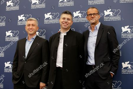 John Denn, Evgeny Afineevsky, John Battsek From left, producer John Denn, director Evgeny Afineevsky, and producer John Battsek pose during the photo call for the movie Winter on fire at the 72nd edition of the Venice Film Festival in Venice, Italy