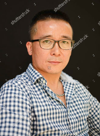 Zhao Liang Director Zhao Liang poses for portraits, at the 72nd edition of the Venice Film Festival in Venice, Italy, . The 72nd edition of the festival runs until Sept. 12