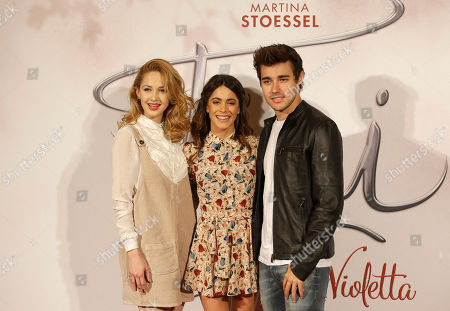 Argentine actress and singer Martina Stoessel, center, poses with Mexican actor Jorge Blanco, right, and Mercedes Lambre, in Milan, Italy