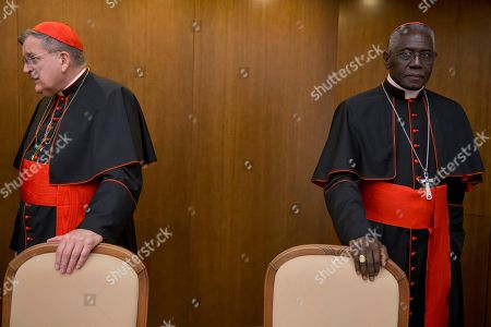 Cardinal Raymond Leo Burke, left, is flanked by Cardinal Robert Sarah, prefect of the Congregation for Divine Worship and the Discipline of the Sacraments, as he arrives for the presentation of his book Divine Love Made Flesh, in Rome