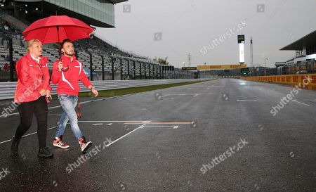 Will Stevens Manor driver Will Stevens of Britain walks on the track after an autograph signing event for fans ahead of the Japanese Formula One Grand Prix at the Suzuka Circuit in Suzuka, central Japan