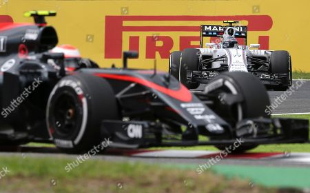 Valtteri Bottas, Will Stevens Williams driver Valtteri Bottas of Finland, back, follows Manor driver Will Stevens of Britain during the third practice session for the Japanese Formula One Grand Prix at the Suzuka Circuit in Suzuka, central Japan