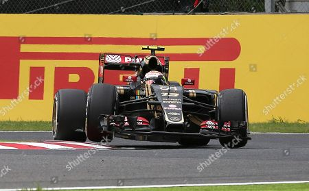 Pastor Maldonado Lotus driver Pastor Maldonado of Venezuela steers his car as the front wheel lifts off the deck during the third practice session for the Japanese Formula One Grand Prix at the Suzuka Circuit in Suzuka, central Japan