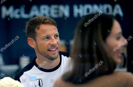 Jenson Button, Jessica Michibata McLaren driver Jenson Button of Britain has a moment with his wife Jessica Michibata at his hospitality suite at the Suzuka Circuit ahead of the Japanese Formula One Grand Prix in Suzuka, central Japan