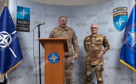 NATO's Supreme Allied Commander for Europe (SACEUR) US General Philip Breedlove, left, and KFOR Commander Maj. Gen. Guglielmo Luigi Miglietta speak during a press conference at the KFOR military headquarters in capital Pristina, Kosovo