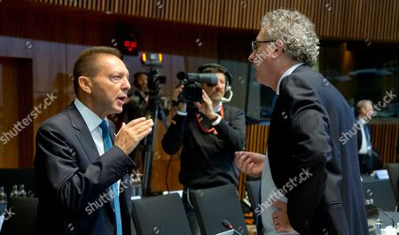 Governor of the Central Bank of Greece Yannis Stournaras, left, speaks with Luxembourg's Finance Minister Pierre Gramegna during a meeting of EU finance ministers at the European Council building in Luxembourg on . European Union finance ministers and central bankers hold informal talks to discuss taxation and ways to further deepen cooperation on the EU's euro single currency