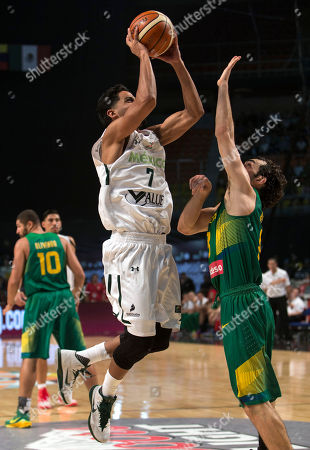 Jorge Gutierrez, Victor Benite Mexico's Jorge Gutierrez, left, goes for a shot over Brazil's Victor Benite during a FIBA Americas Championship basketball game in Mexico City