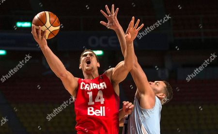 Dwight Powell, Orestes Torres Canada's Dwight Powell, left, goes for a shot over Cuba's Orestes Torres during a FIBA Americas Championship basketball game in Mexico City