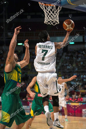Jorge Gutierrez, J P Batista Mexico's Jorge Gutierrez, right, goes for a shot over Brazil's J P Batista during a FIBA Americas Championship basketball game in Mexico City