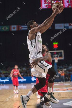 Jorge Gutierrez, Renaldo Walkman Mexico's Jorge Gutierrez, top, goes for a shot over Puerto Rico's Renaldo Walkman during a FIBA Americas Championship basketball game in Mexico City
