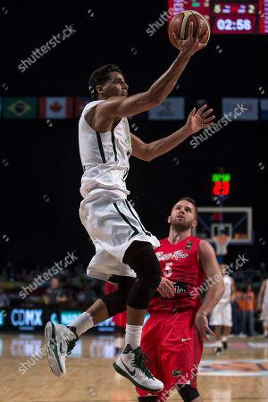 Jorge Gutierrez, Juan Barea Mexico's Jorge Gutierrez, top, goes for a shot over Puerto Rico's Juan Barea during a FIBA Americas Championship basketball game in Mexico City