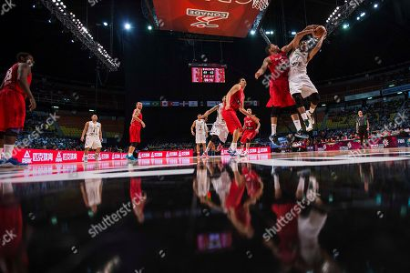 Jorge Gutierrez, Angel Vasallo Mexico's Jorge Gutierrez, right, goes for a shot over Puerto Rico's Angel Vasallo during a FIBA Americas Championship basketball game in Mexico City