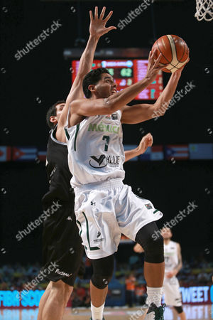 Jorge Gutierrez, Tayavek Gallizzi Mexico's Jorge Gutierrez, right, goes for a shot over Argentina's Tayavek Gallizzi during a FIBA Americas Championship basketball game in Mexico City