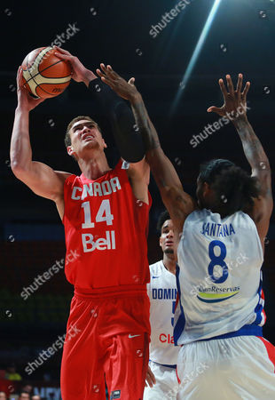 Dwight Powell, Edward Santana Canada's Dwight Powell, left, goes for a shot over Dominican Republic's Edward Santana during a FIBA Americas Championship basketball game in Mexico City