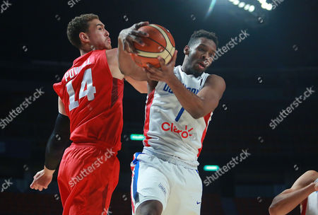 Angel Suero, Dwight Powell Dominican Republic's Angel Suero, right, fights for the ball against Canada´s Dwight Powell during a FIBA Americas Championship basketball game in Mexico City