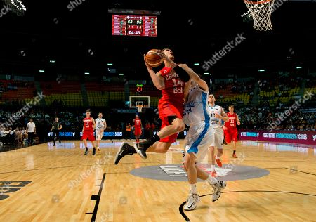 Powel Dwight, Hernando Caceres Canada's Dwight Powell, left, goes for a shot over Uruguay's Hernando Caceres, right, during a FIBA Americas Championship basketball game in Mexico City