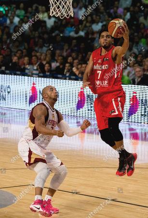 Jorge Gutierrez, David Cubillan Mexico's Jorge Gutierrez, right, goes for a shot over Venezuela's David Cubillan, left, during a FIBA Americas Championship basketball game in Mexico City