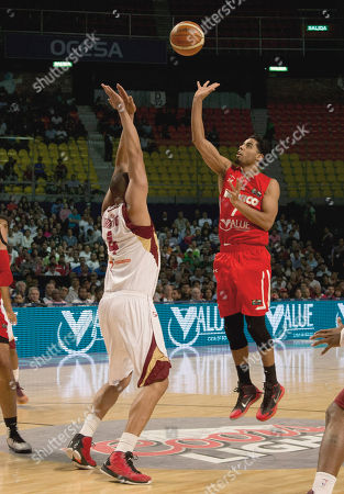 Jorge Gutierrez, Miguel Marriaga Mexico's Jorge Gutierrez, right, goes for a shot over Venezuela's Miguel Marriaga, left, during a FIBA Americas Championship basketball game in Mexico City