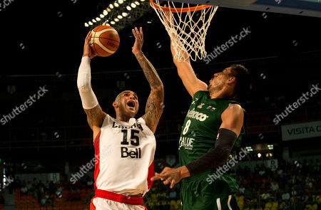 Stock Photo of Robert Sacre, Gustavo Ayon Canada's Robert Sacre goes for a shot over Mexico's Gustavo Ayon during their FIBA Americas Championship third place basketball game in Mexico City